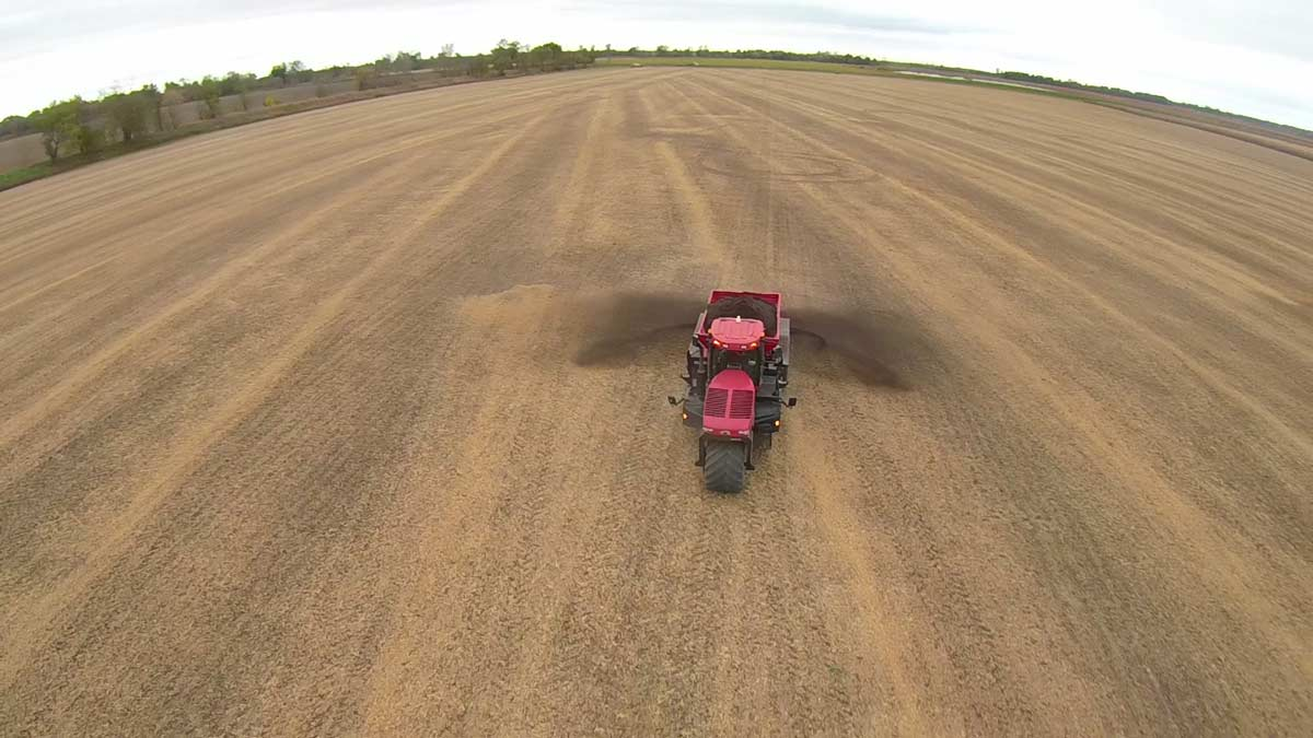Tractor Spreading Plant Tuff® in Farm Field