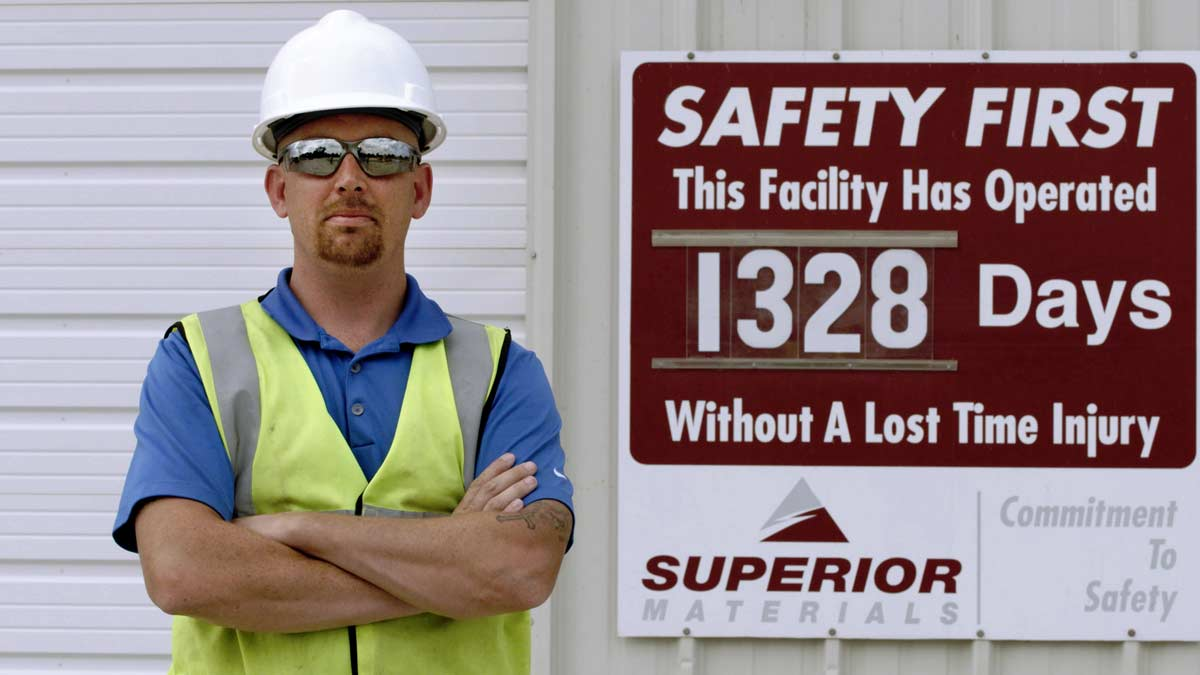 Employee by Safety Sign, Superior Materials