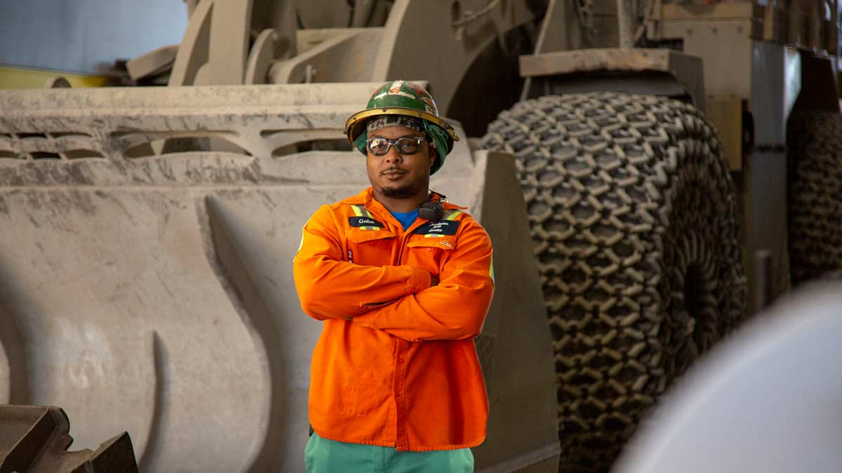 Employee in Front of Payloader
